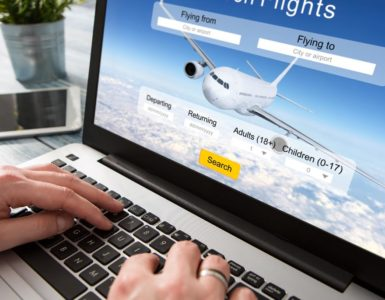 booking a flight online through website on laptop